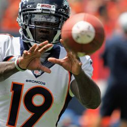 Broncos WR Fred Brown watches a pass come to him at training camp practice.