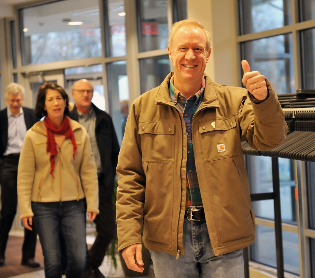 Then-Republican gubernatorial candidate Bruce Rauner and his wife Diana arrive at their Winnetka polling place in 2014. File Photo.   Al Podgorski / Sun-Times Media