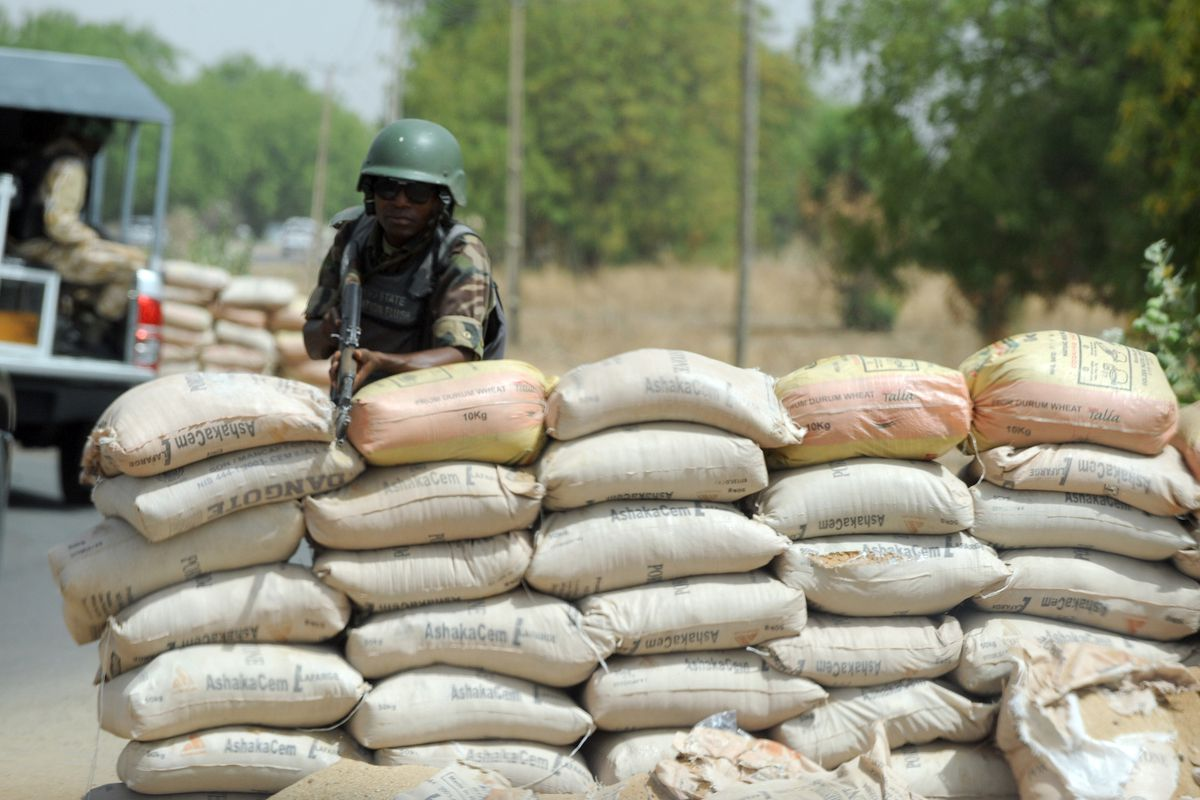 A Nigerian soldier guards a checkpoint in the country's north
