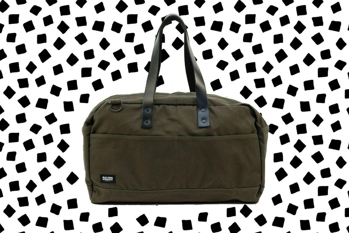 An olive weekender bag