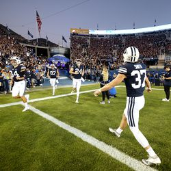 BYU players get warmed up as they and USF prepare to play a college football game at LaVell Edwards Stadium in Provo on Saturday, Sept. 25, 2021.