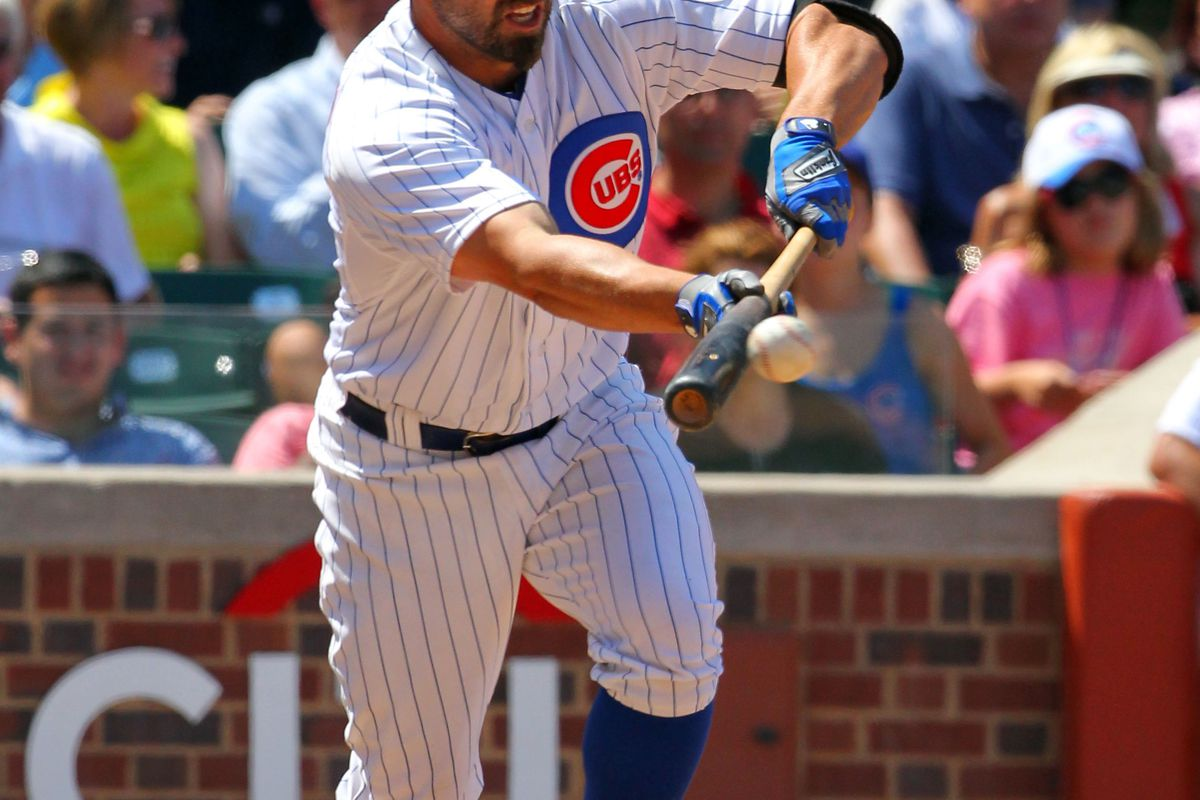 Chicago, IL, USA; Chicago Cubs right fielder Reed Johnson executes a suicide squeeze bunt for a single to score Tony Campana (not pictured) against the St. Louis Cardinals  at Wrigley Field. Credit: Dennis Wierzbicki-US PRESSWIRE