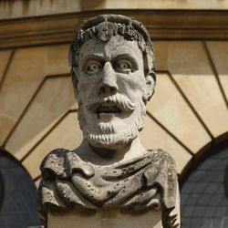 A statue adorns a building at Oxford University, England, on June 14, 2017.