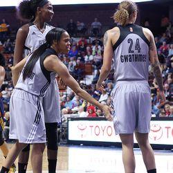 San Antonio Stars' Moriah Jefferson (4) gives encourage to her teammate Jazmon Gwatchmey (24).