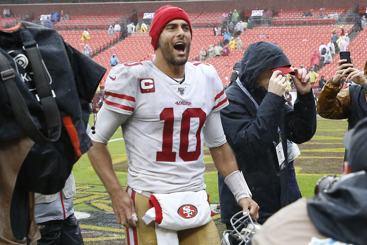 San Francisco 49ers quarterback Jimmy Garoppolo celebrates while leaving the field after the 49ers game against Washington at FedExField.