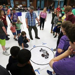 """Students face off in a """"sumobot"""" competition as middle school students who have been involved in an after-school STEM program compete in West Jordan on Wednesday, May 27, 2015."""