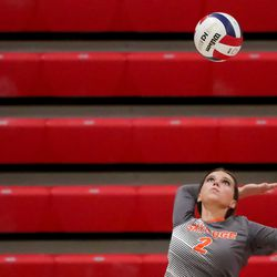 Skyridge's Emma Grant Serves against Mountain Ridge in a girls volleyball match in Herriman on Tuesday, Sept. 7, 2021.