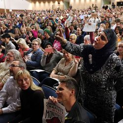 Noor Ul-Hasan asks Rep. Jason Chaffetz, R-Utah, a question during a town hall meeting at Brighton High School in Cottonwood Heights on Thursday, Feb. 9, 2017.