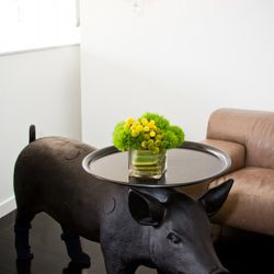 Yes, that's a pig table, and yes, the pig is wearing socks.