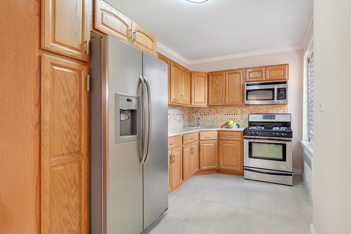 A kitchen with wood cabinetry.