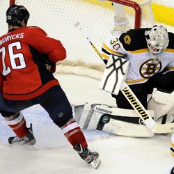 Boston Bruins goalie Tim Thomas (30) defends the net against Washington Capitals left wing Matt Hendricks (26) during the second period of Game 6 of an NHL hockey Stanley Cup first-round playoff series, Sunday, April 22, 2012, in Washington.