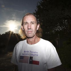 """In this July 19, 2011 photo, Bryan Black, with the North Texans for 9/11 Truth group, poses for a photo in Dallas. Nationwide, the skeptics, who prefer the term """"9/11 truth activists"""" instead of the moniker """"truthers,"""" generally have about a dozen beliefs surrounding what happened on that day, although there are some variations on who was responsible for the attacks and why. Among the beliefs: that the World Trade Center buildings could never have collapsed due to fire, that the buildings were brought down by explosives, that there were warnings of the impending attacks from 11 different countries and that fighter jets could have intercepted at least one of the four planes that day. Many believe that there were criminal elements within the government that caused the attacks."""