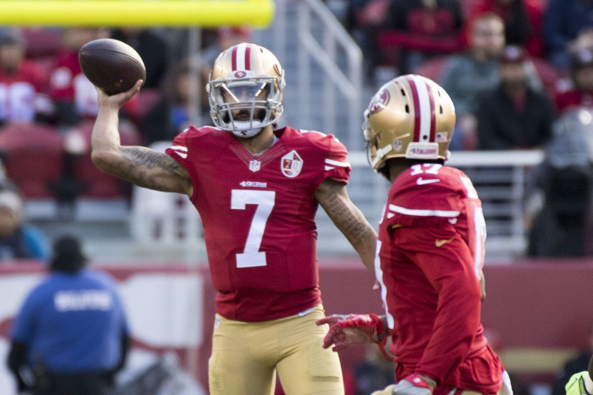 San Francisco 49ers quarterback Colin Kaepernick passes the football to wide receiver Jeremy Kerley against the Seattle Seahawks during the first quarter at Levi's Stadium.