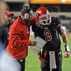 Utah quarterback coach Brian johnson talks with Jon Hayes as the University of Utah defeats Oregon State University 27-8 to win their first  conference  PAC12 football game Saturday, Oct. 29, 2011, in Salt Lake City, Utah.  (Tom Smart, Deseret News)