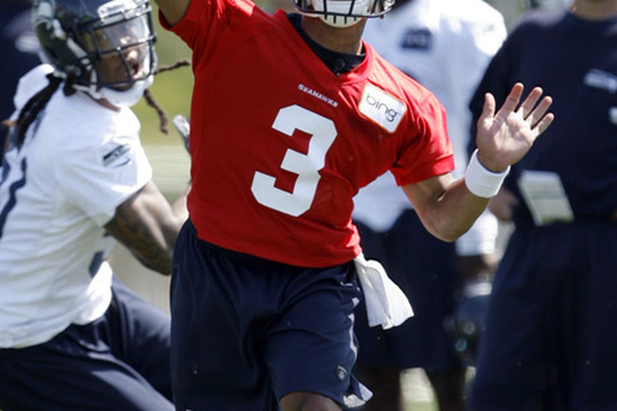 May 11, 2012; Renton, WA, USA; Seattle Seahawks quarterback Russell Wilson (3) passes during a minicamp scrimmage at the Virginia Mason Athletic Center. Mandatory Credit: Joe Nicholson-US PRESSWIRE