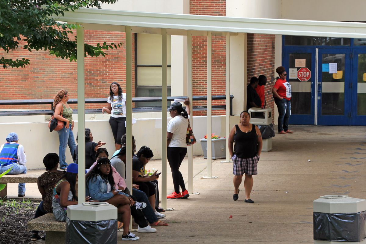 Parents stand outside of Ridgeway High School on Wednesday, June 3, 2015. Long lines piled up for summer school registration.