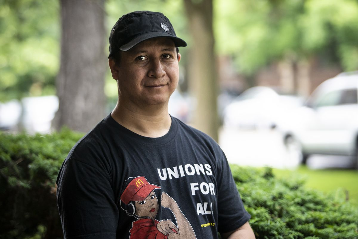 Carlos De Leon, 40, who works for McDonald's, outside his Northwest Side home.