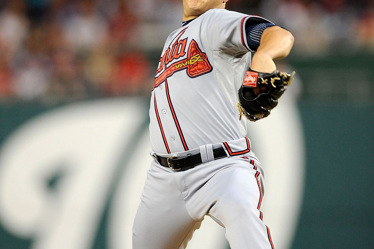 WASHINGTON, DC - AUGUST 22:  Kris Medlen #54 of the Atlanta Braves throws a pitch against the Washington Nationals at Nationals Park on August 22, 2012 in Washington, DC.  (Photo by Patrick McDermott/Getty Images)