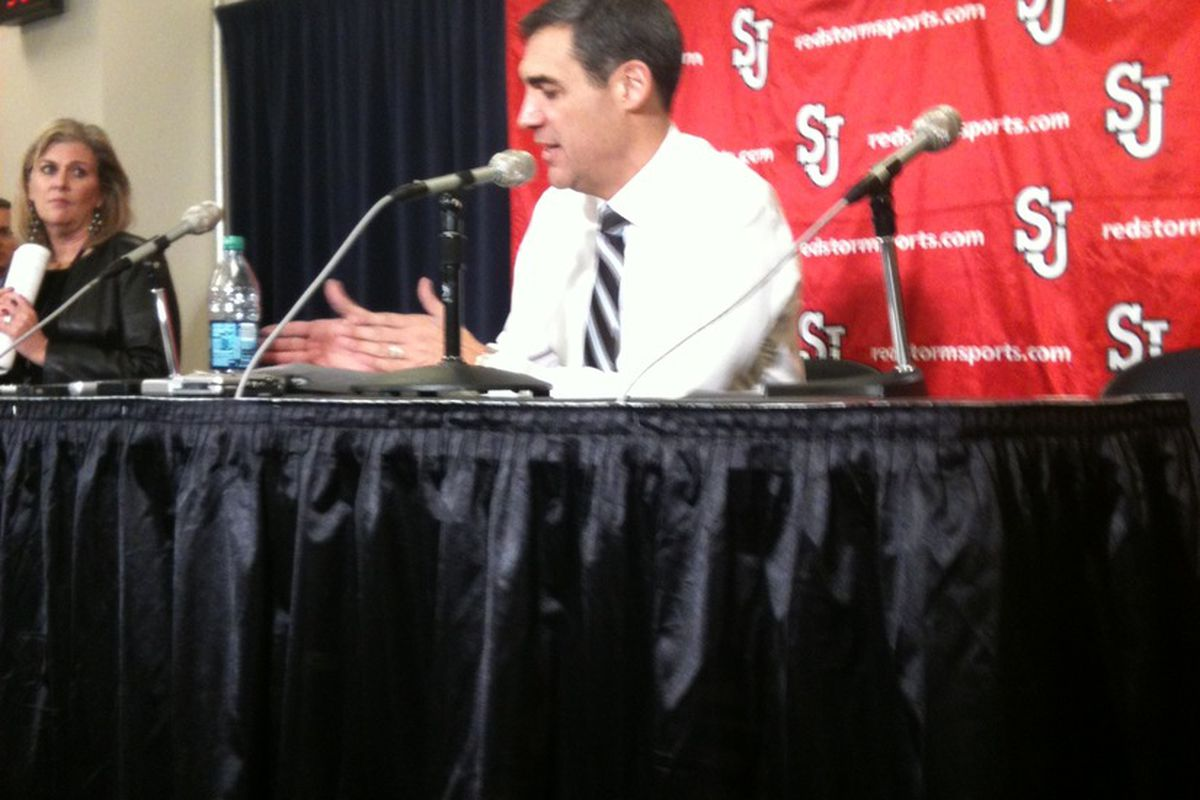 Jay Wright at the podium after his Wildcats' win over St. John's.
