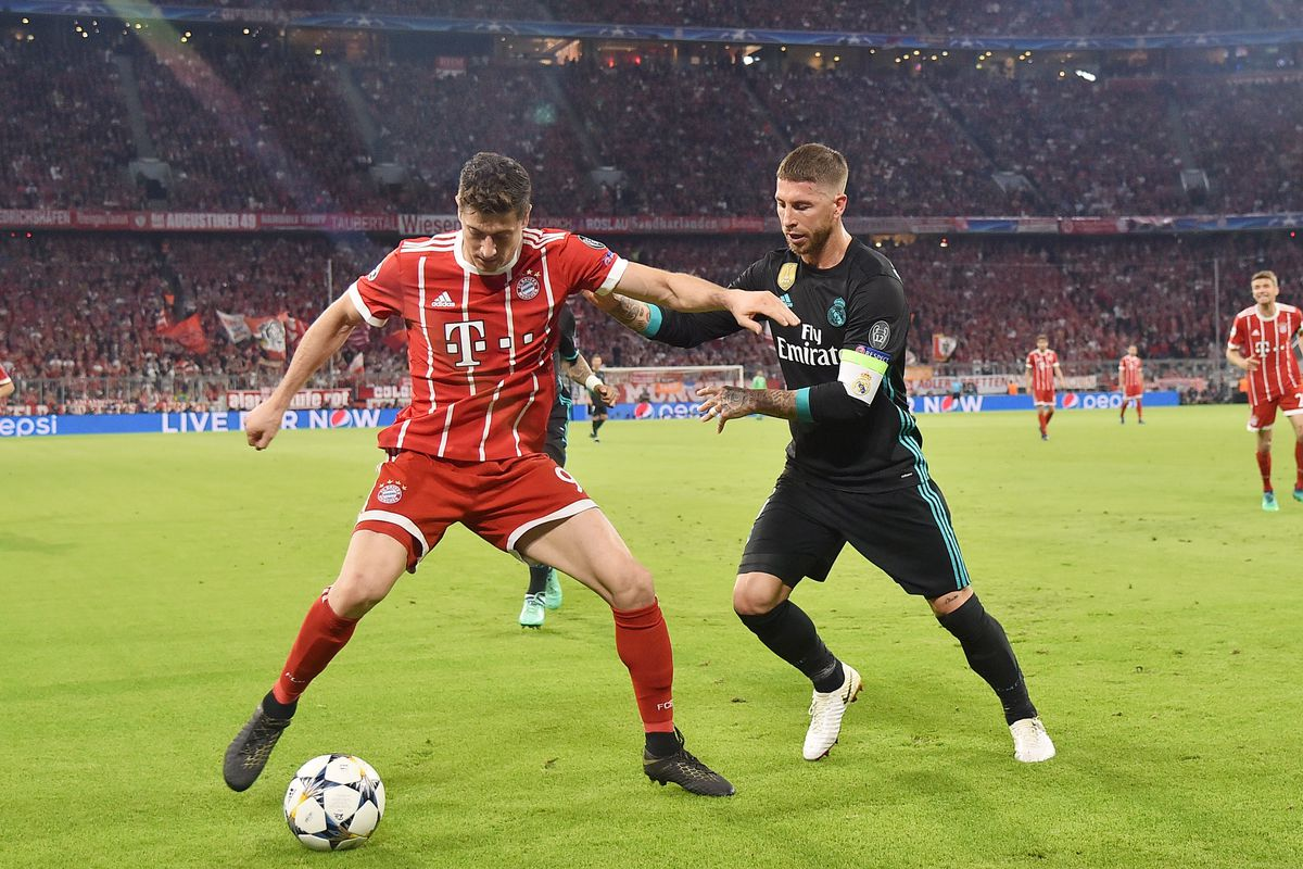 Bayern Muenchen v Real Madrid - UEFA Champions League Semi Final Leg One MUNICH, GERMANY - APRIL 25: Robert Lewandowski of Bayern Muenchen competes with Sergio Ramos of Real Madrid during the UEFA Champions League Semi Final First Leg match between Bayern Muenchen and Real Madrid at the Allianz Arena on April 25, 2018 in Munich, Germany.
