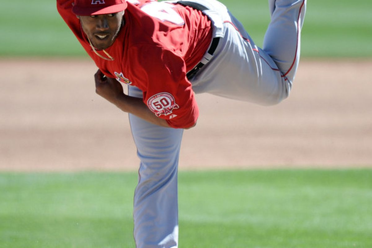 Trevor Reckling #43 of the Los Angeles Angels pitches agains the Los Angeles Dodgers in the seventh inning during spring training at Camelback Ranch on February 27, 2011 in Phoenix, Arizona