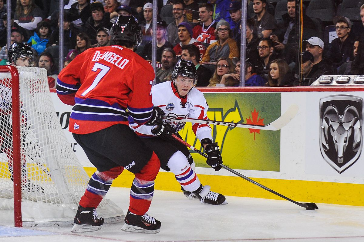 Brendan Lemieux, with puck, about to engage Anthony DeAngelo in the CHL Top Prospects Game