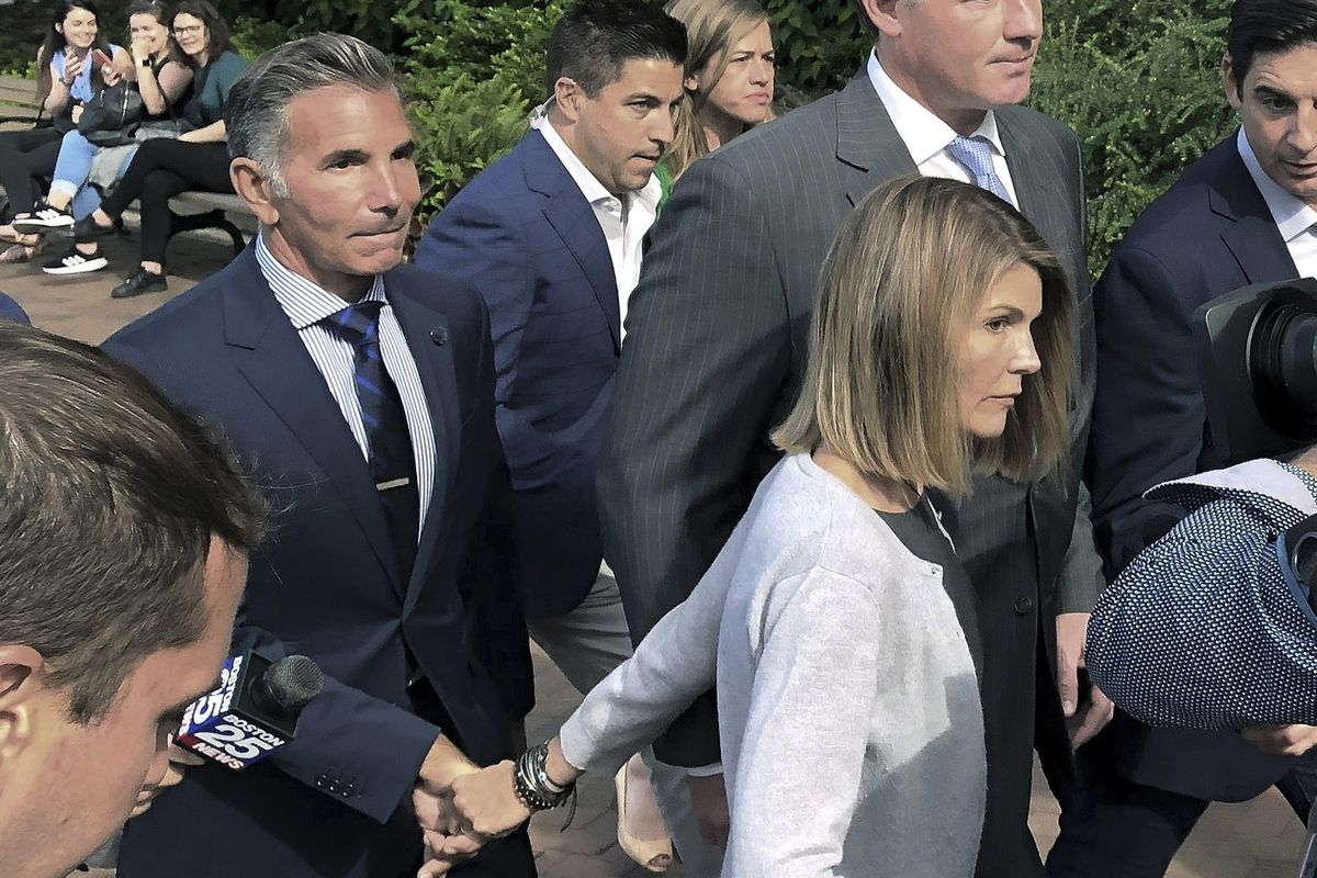 Lori Loughlin departs federal court in Boston with her husband, Mossimo Giannulli.