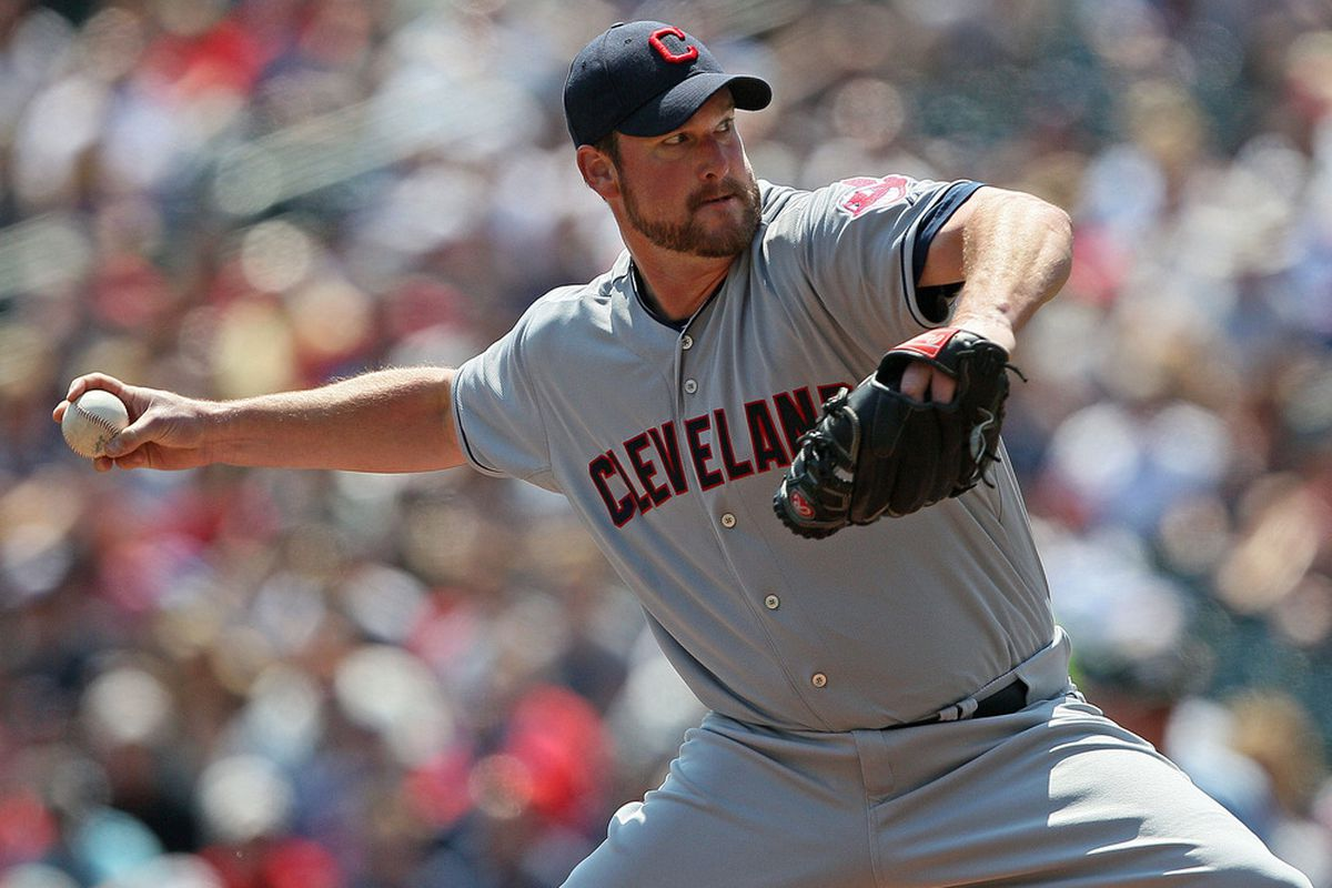 May 15, 2012; Minneapolis, MN, USA: Cleveland Indians starting pitcher Derek Lowe (26) delivers a pitch in the first inning against the Minnesota Twins at Target Field. Mandatory Credit: Jesse Johnson-US PRESSWIRE