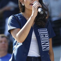 Gina Salvatore sings the God Bless America during the 7th inning stretch at the Tulane/ UConn baseball game at Dunkin Donuts Park.