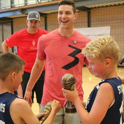 Jimmer Fredette interacts with participants during his Jimmerosity Jam 3on3 Tournament to Stop Bullying in Provo earlier this summer.