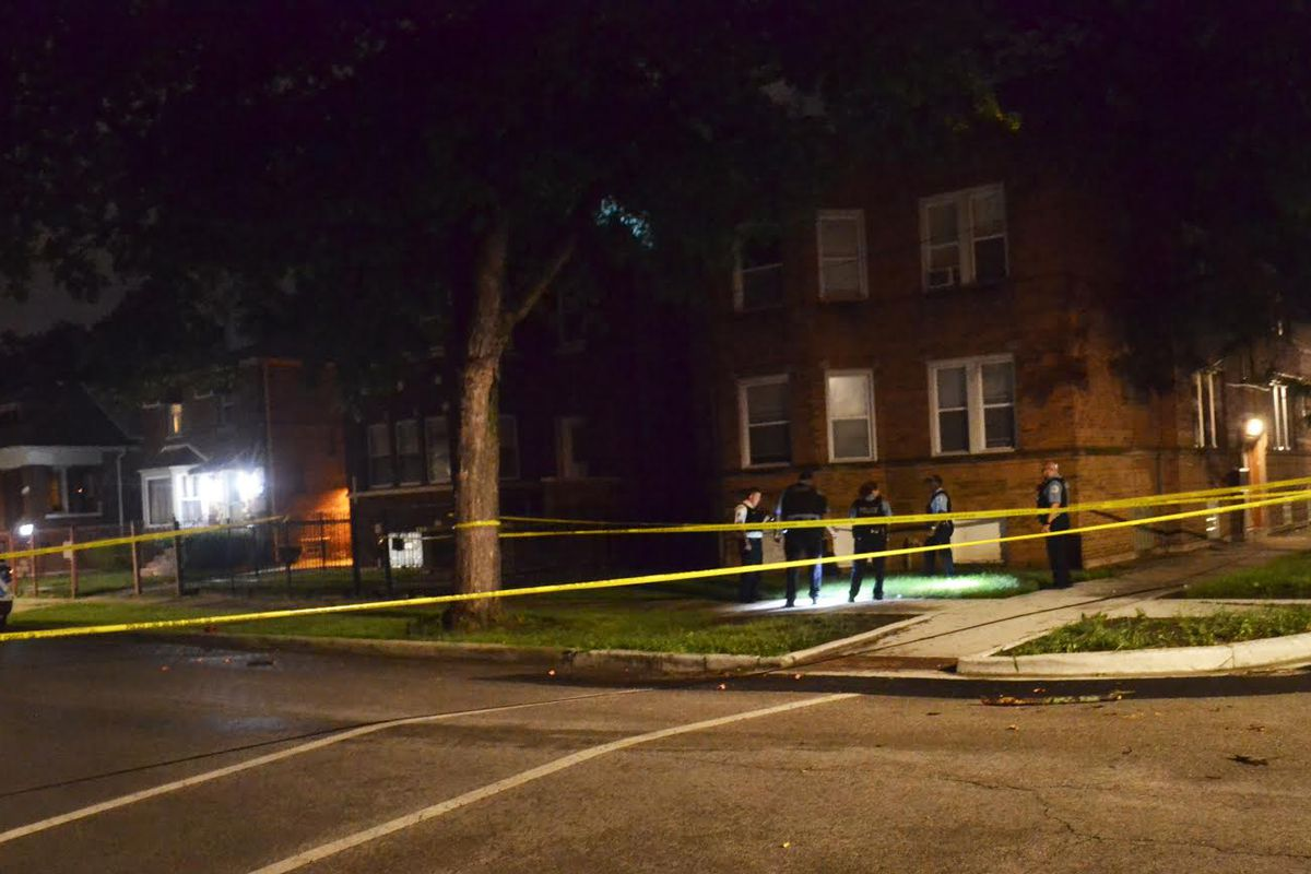 Chicago police investigate the scene of a shooting