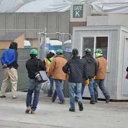 Workers checking in just before 3 p.m. outside Gate K