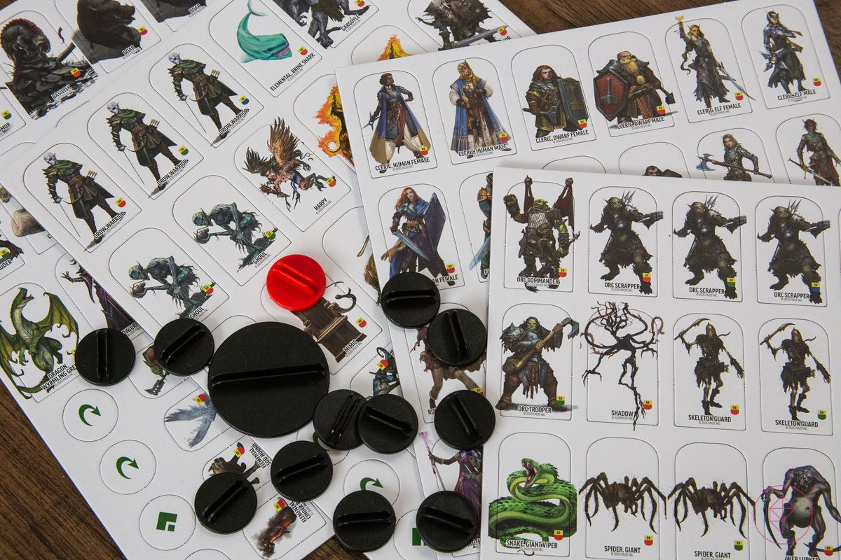 A selection of cardboard tokens, 124 in total, with plastic stand.