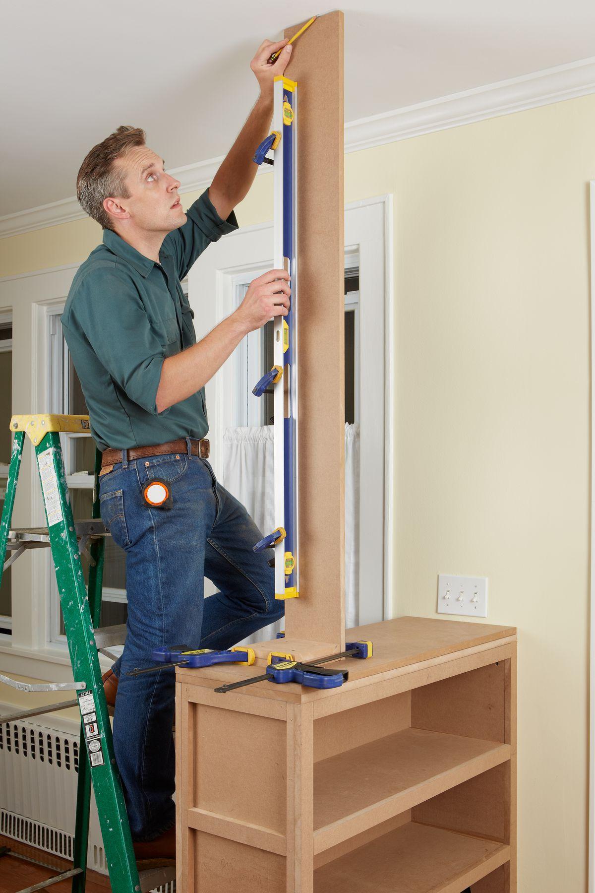 Man Measures Size Of Column