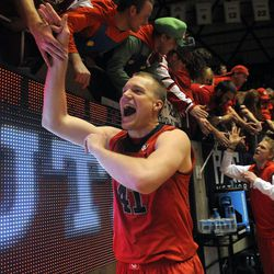 Utah Utes center Jeremy Olsen (41) is congratulated by the student body after defeating BYU 81-64 during a game at the Jon M. Huntsman Center on Saturday, Dec. 14, 2013.