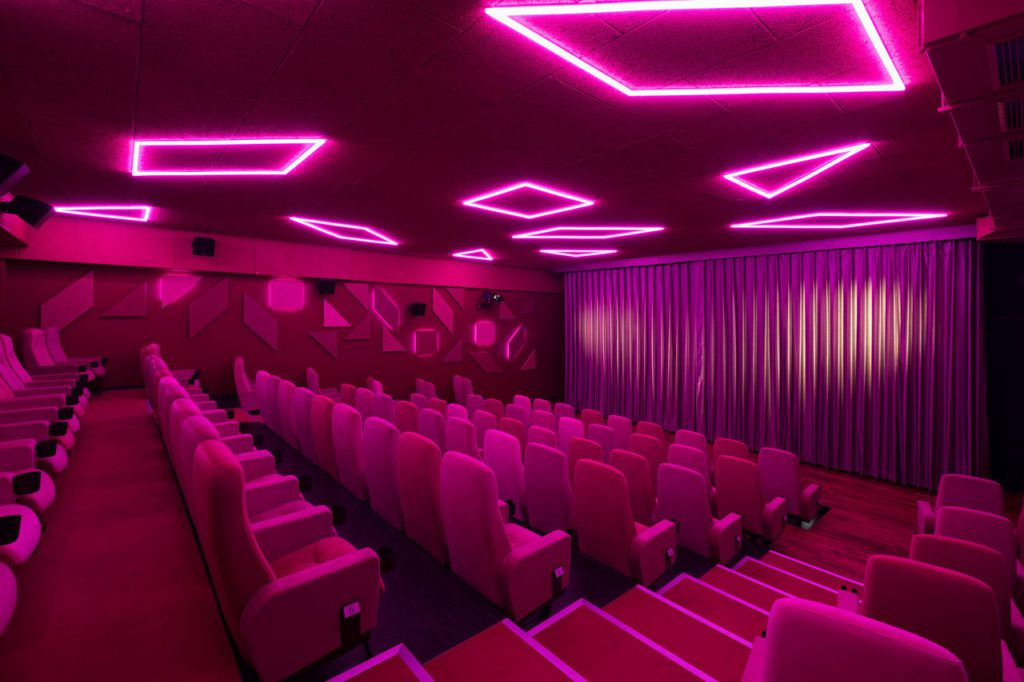 Theater with fuchsia fluorescent lights