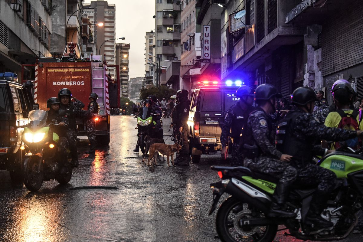 Security forces take security measures around the site after an explosion was heard while Venezuelan President Nicolas Maduro was attending a ceremony to celebrate the 81st anniversary of the National Guard in Caracas on August 4, 2018.