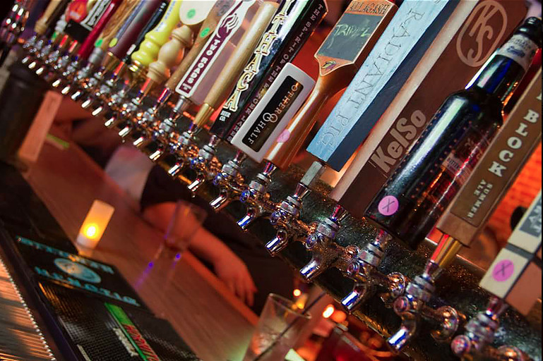 Taps with lots of beer logos