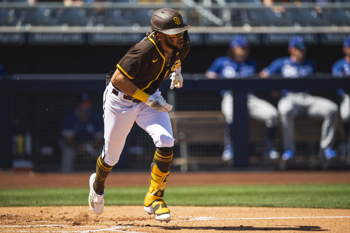 Infielder Fernando Tatis Jr. #23 of the San Diego Padres runs down the first baseline against the Los Angeles Dodgers at the Peoria Sports Complex on March 20, 2021 in Peoria, Arizona.