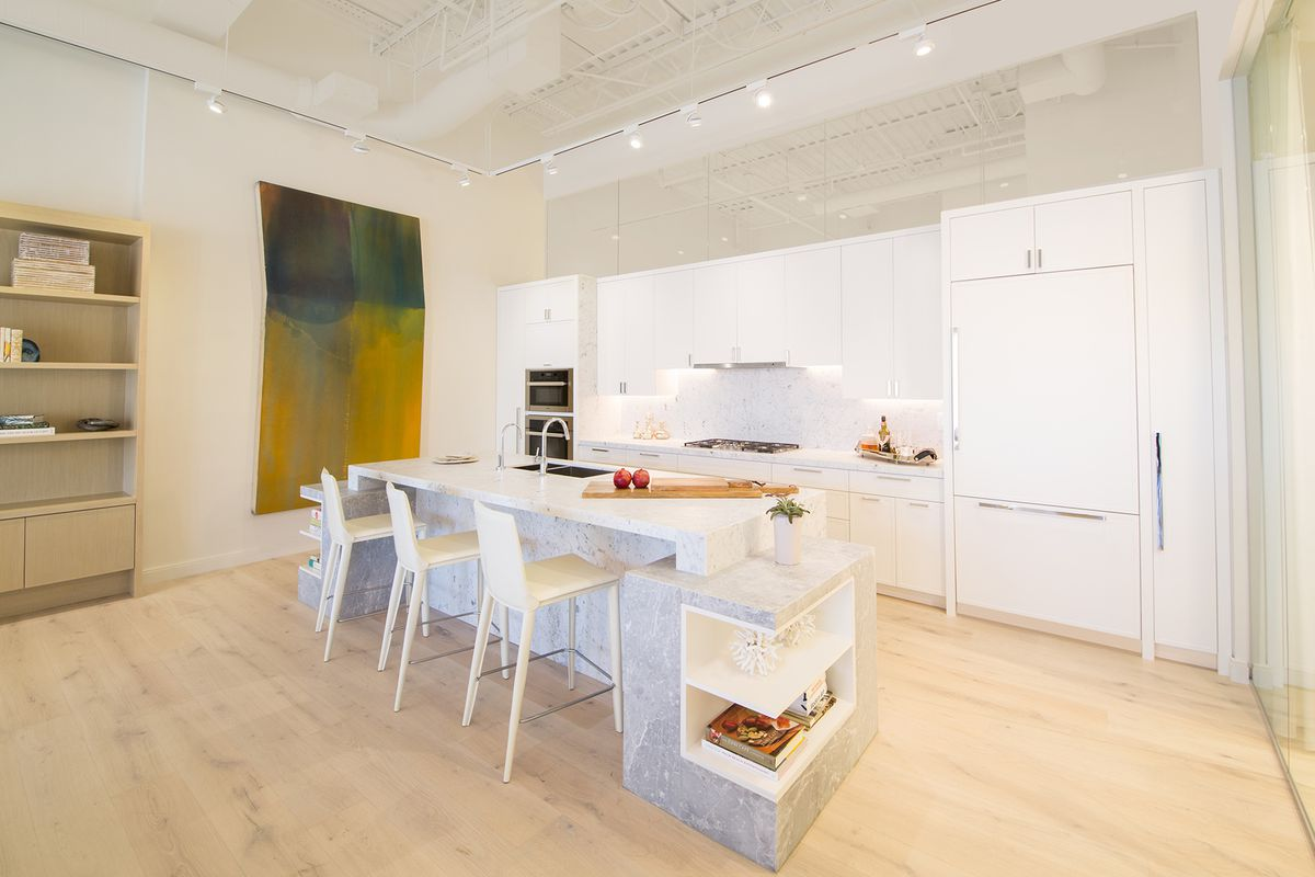 Inside the 3550 South Ocean sales gallery in Palm Beach, showing a bright and modern open kitchen.
