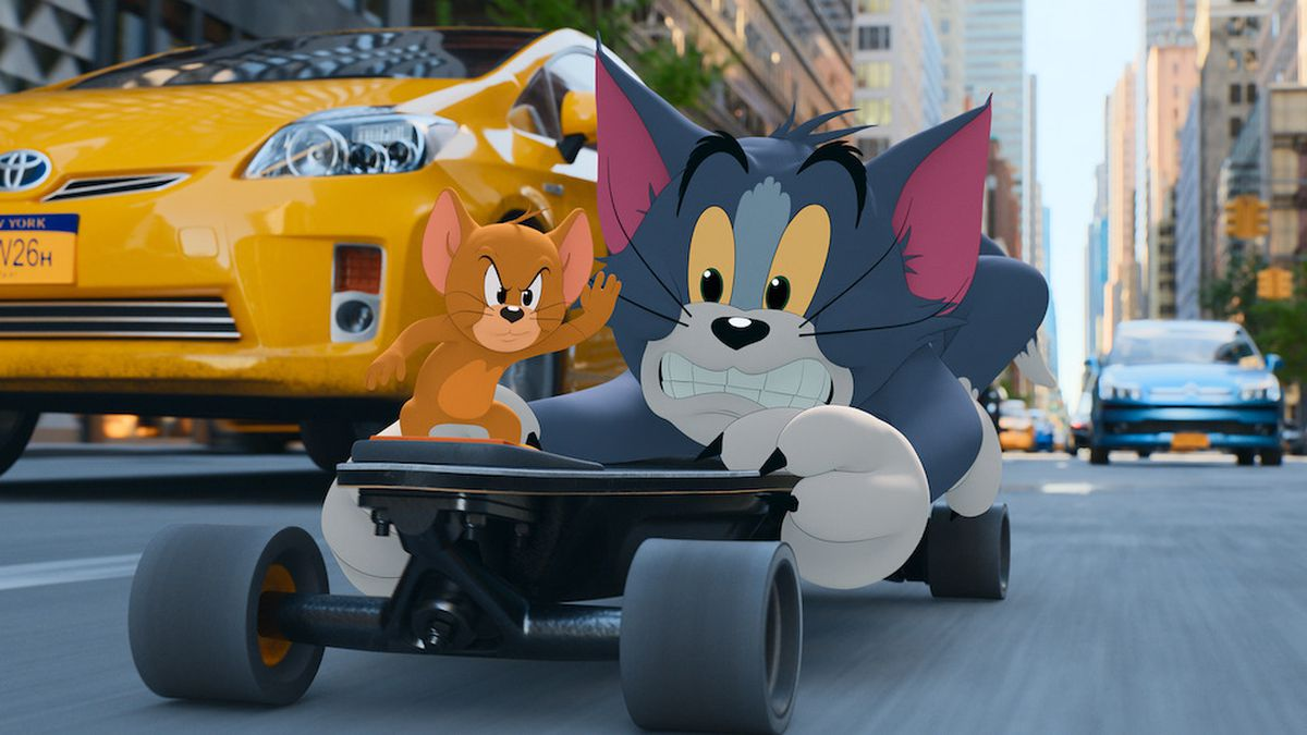 A grimacing Tom and a confident Jerry ride a skateboard down the street in Tom & Jerry