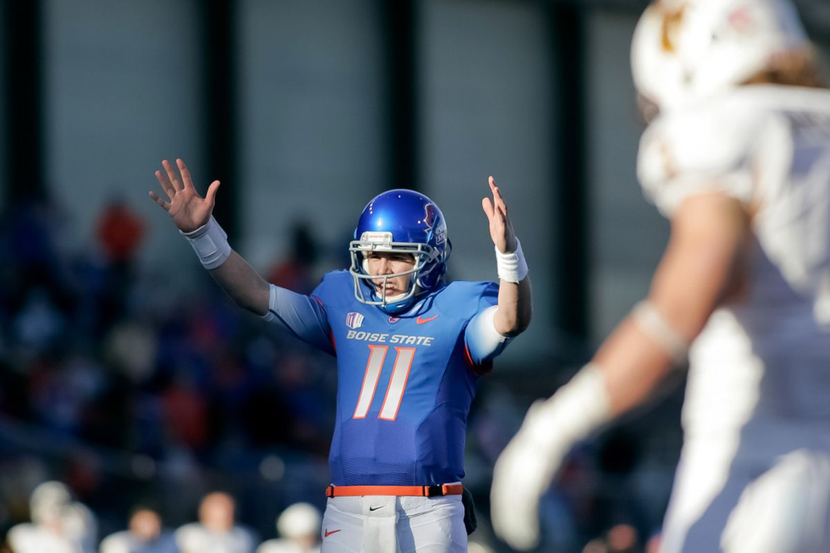BOISE, ID - NOVEMBER 26: Kellen Moore #11 of the Boise State Broncos celebrates a touchdown against the Wyoming Cowboys at Bronco Stadium on November 26, 2011 in Boise, Idaho.  (Photo by Otto Kitsinger III/Getty Images)