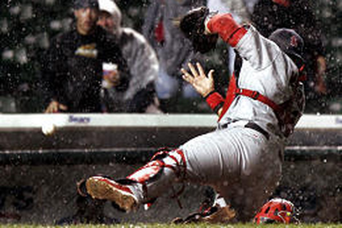 St. Louis catcher Yadier Molina drops a ball in foul territory. A catch would have ended the game.
