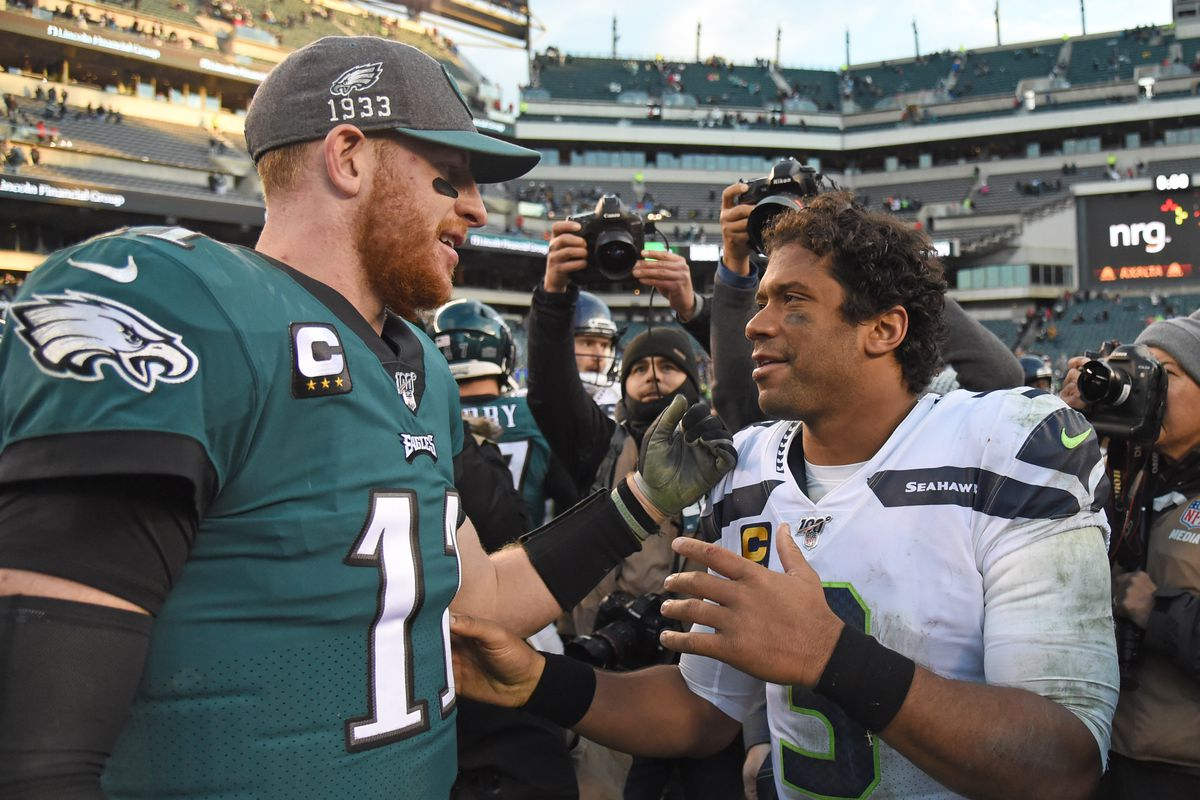 Philadelphia Eagles quarterback Carson Wentz and Seattle Seahawks quarterback Russell Wilson on the field after game at Lincoln Financial Field.