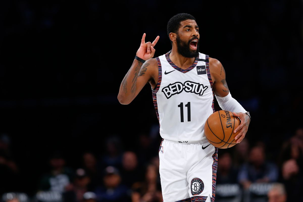 Brooklyn Nets guard Kyrie Irving handles the ball against the Milwaukee Bucks during the first half at Barclays Center.