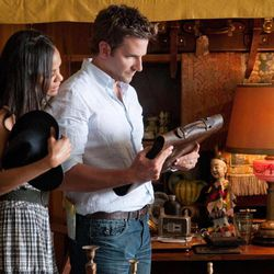 """This film image released by CBS Films shows Bradley Cooper, right, and ZoË Saldana in a scene from """"The Words."""""""