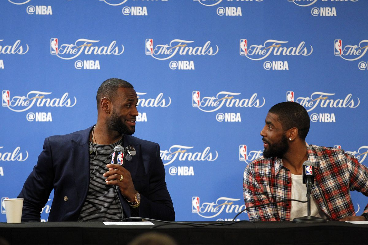 LeBron and Kyrie celebrate after avoiding elimination