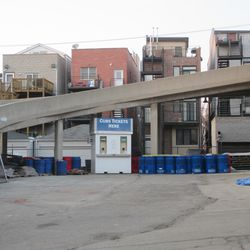 Ticket booth and recycling containers in the Brown Lot -