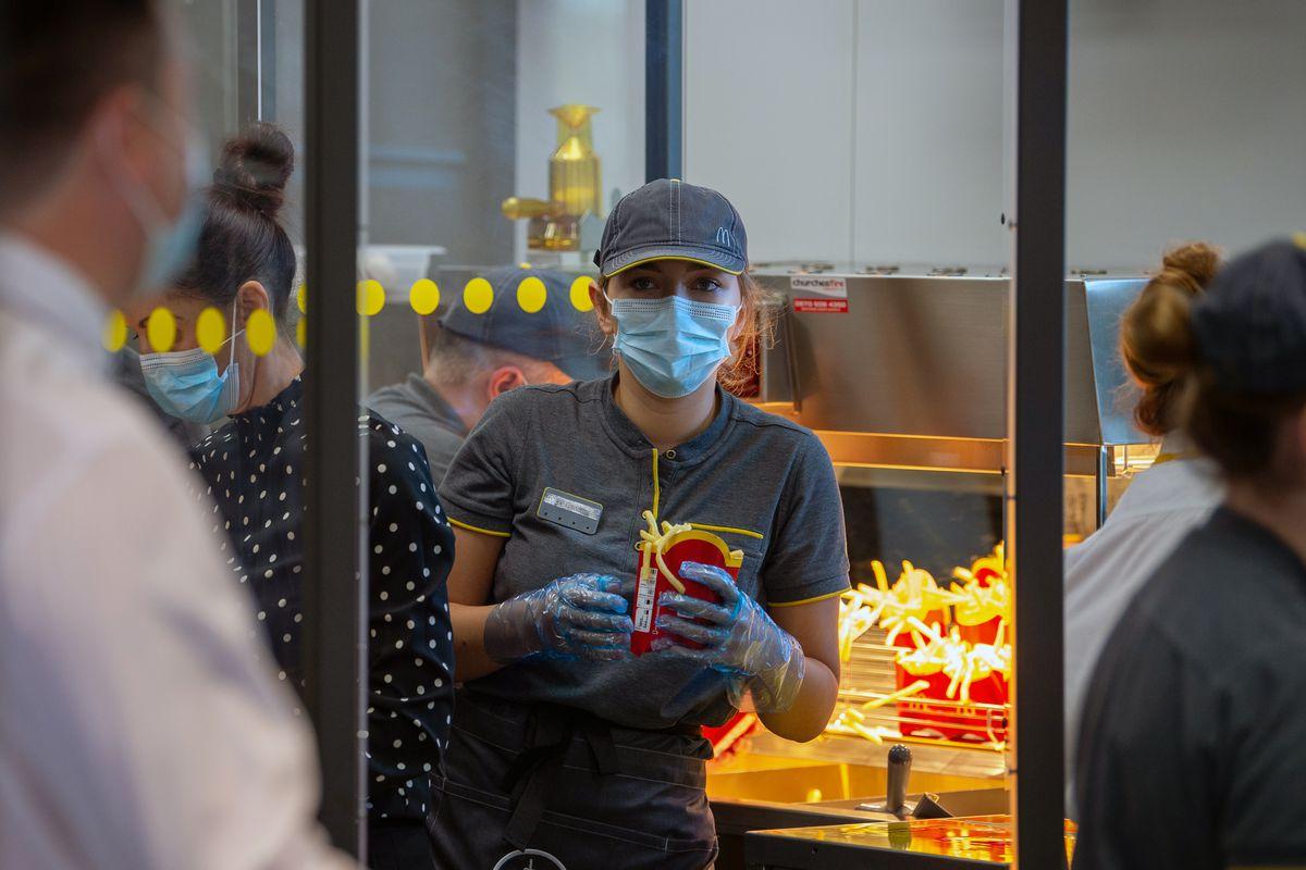 A McDonald's worker wears a mask at its Rutland restaurant