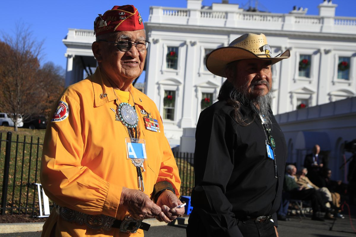 Navajo Code Talker Thomas Begay and retired U.S. Army Col. Ronald Begay tour the White House.